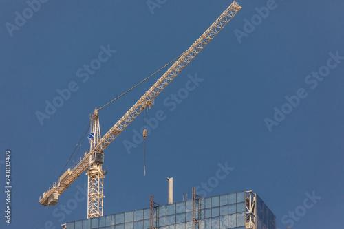 Construction worker in Dubai Marina in a summer day, United Arab