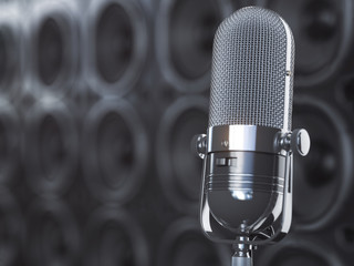 Microphone on black background from  professional loudspeakers and subwoofers. Audio and music concept.