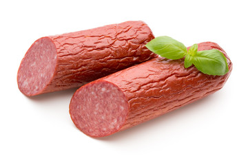 Salami smoked sausage, basil leaves on white background cutout.