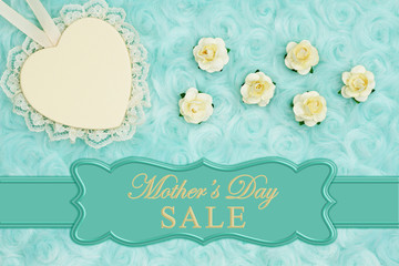 Mother's Day Sale message with a heart with lace on pale teal rose plush fabric