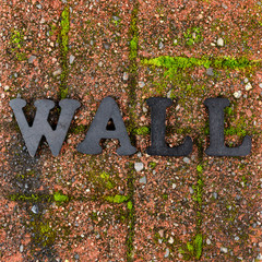 Red grunge brick with metal letters for wall concept