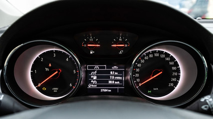 Vehicle front panel with fuel consumption data.