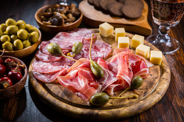 Serrano ham platter with variation of appetizers