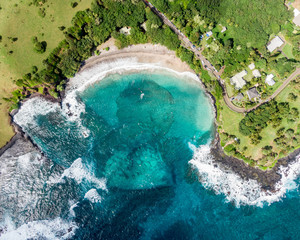 "Stunning aerial view of Hamoa Beach,  a remote beach located near the little town of Hana on the east side of the island of Maui, Hawaii. Hamoa Beach is consistently named one of ""Maui's Best Beaches"""