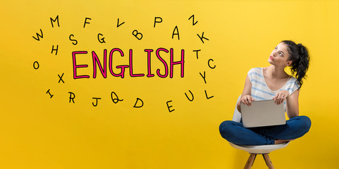 Learning English theme with young woman using a laptop computer