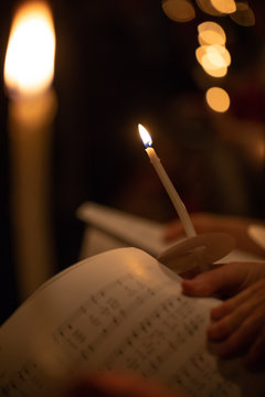 Carolers by candle light