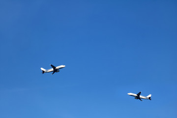 Airplane in the sky with white clouds and blue sky at samui island