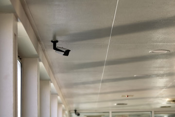 CCTV cameras on the ceiling of the  transportation cabin.