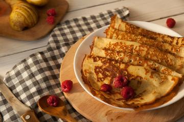Pancakes Thin homemade pancakes with berries, traditional Russian cuisine. Homemade pancakes with berries