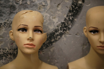 The heads of destroyed mannequins are placed in a corner in an anger room in Beijing