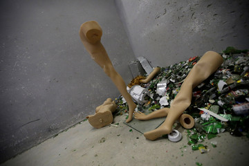 Destroyed mannequins are seen in a corner in an anger room in Beijing