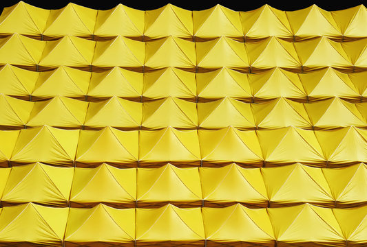 Full Frame Background of Yellow Canvas Roofs Isolated on Black