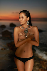 Sexy Woman With Topless Slim Body On Sea Beach At Sunset