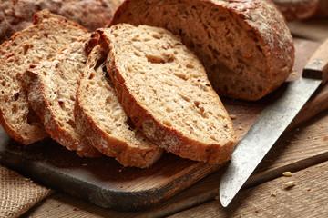 Fotobehang Brood fresh baked sliced bread on wooden background