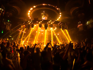 People are dancing in night club
