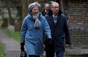 Britain's Prime Minister Theresa May and her husband Philip leave church, near High Wycombe