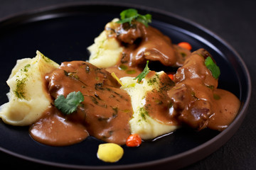 meat restaurant, european cuisine, banquet. beef cheeks braised in gravy with potato puree, spanish food, steak, barbecue