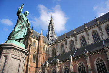 Saint Bavo Cathedral and statue of Laurens Janszoon Coster in the old town of Haarlem, Netherlands
