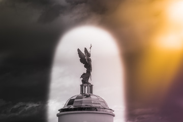 Archangel Michael sculpture against the sky in the arch.