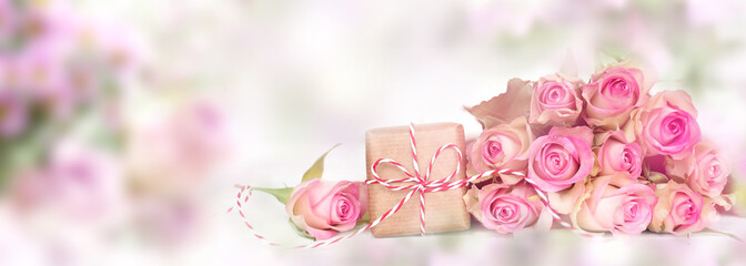 Pink roses with a smal gift