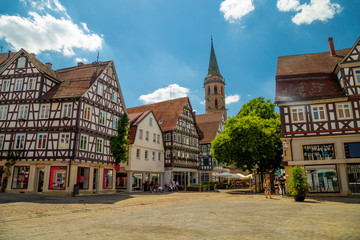 Schorndorf, main square of historical centre and a tower of Stadtkirche church, a town in Baden-Württemberg, Germany