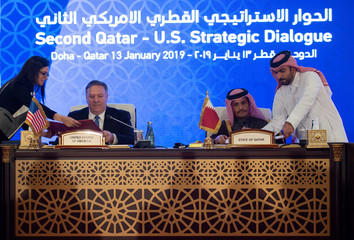 U.S. Secretary of State Mike Pompeo signs an MOU and statement of intent with Mohammed bin Abdulrahman bin Jassim Al Thani, the Deputy Prime Minister and Qatari Minister of Foreign Affairs, at the Sheraton Grand in the Qatari capital Doha