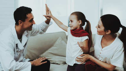 Doctor Visiting Little Girl in Red Scarf with Cold