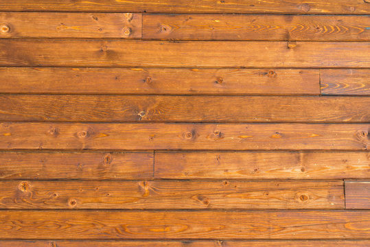 Horizontal pine wood wall close up shot, image for background.