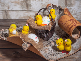 Easter funny picture with painted faces on the eggs. Toy Chicks