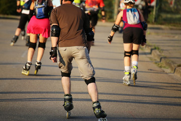 Group of roller blader in the evening sun
