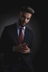 portrait of handsome businessman in navy suit praying