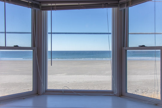 box bay window overlooking beautiful beach with no one on it