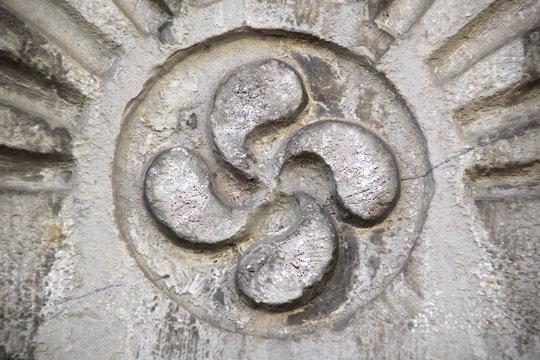 The lauburu or Basque cross.