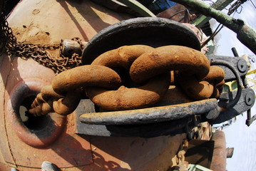 rusted big chain in river port