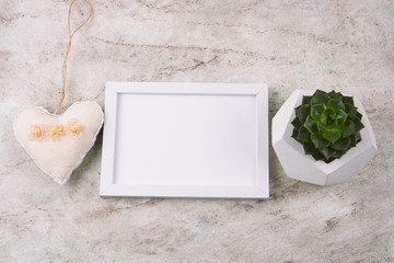top view white frame copy space, succulent pot and heart on marble background