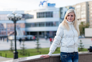 Blond woman over urban background
