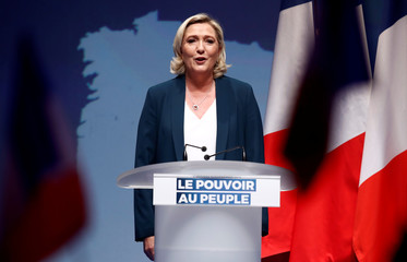 French far-right National Rally (Rassemblement National) party leader Marine Le Pen sings the national anthem during the launching of National Rally (Rassemblement National) party campaign for the European elections in Paris