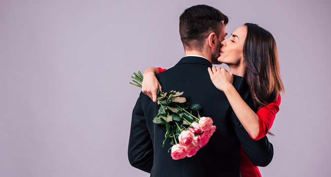 Love forever. Excited and happy couple in love are hugging, kissing and celebrating the St Valentines day. Celebration, holidays and gifts concepts. St Valentines dat. Lovers day