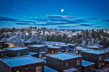 Blue hour over Oslo a winter morning with snow in the air. Norway