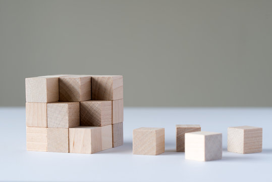 Wood cubes to complete a bigger square block