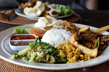 Nasi Campur Bebek Goreng or also known as Mixed rice with duck meat, famous Balinese cuisine