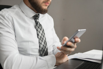 Close up telephone. Shopping online. Office work concept. Sending email, mobile phone. Businessman working with documents Businessman uses a smartphone. White background.