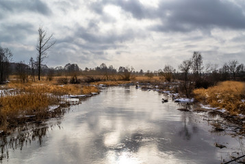 Winter and river Grabia in central Poland.
