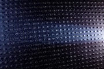 Horizontal white light on a blue background in black dot