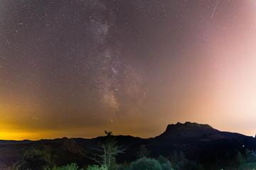Milky way over Aiako Harriak (Peñas de Aya) basque mountain located near Donostia-San Sebastian, Basque Country.