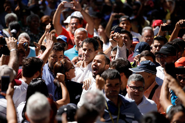 Juan Guaido, President of the Venezuelan National Assembly and lawmaker of the opposition party Popular Will (Voluntad Popular), greets supporters during a gathering in La Guaira