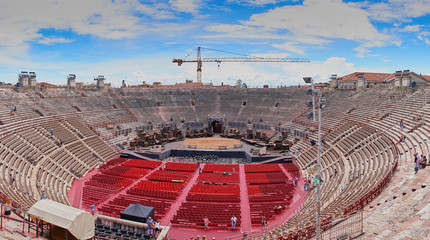 Inside of Arena of Verona in Italy /  Red seats under blue sky in the theater