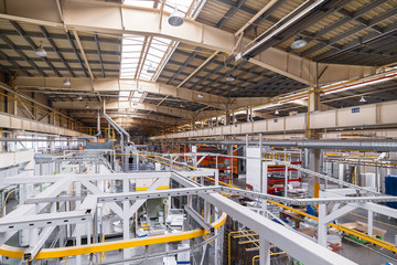 Industrial line of dry painting of metal products. Overhead conveyor system.