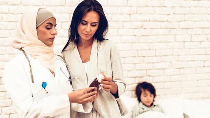 Arabic Pediatrician Giving Medicine Mom Sick Son