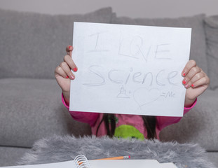 "Two hands are holding a sign with the text ""I Love Science"""
